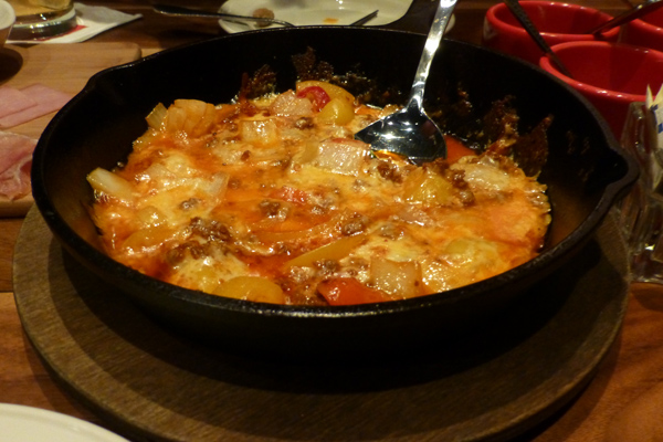 The Queso Fundido has has chunks of onion and peppers.