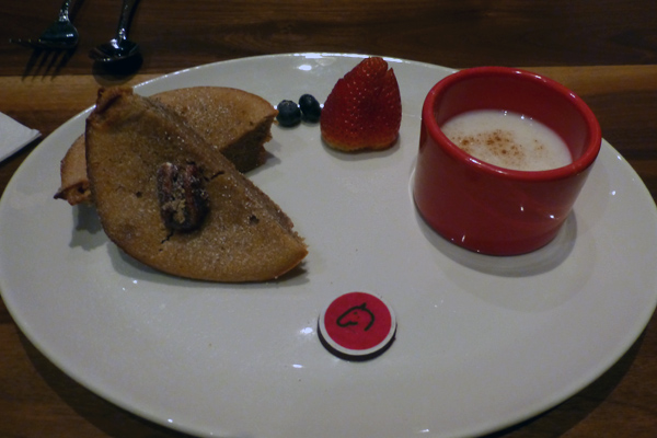 The Flourless Pecan Cake is served with Atole de Arroz.